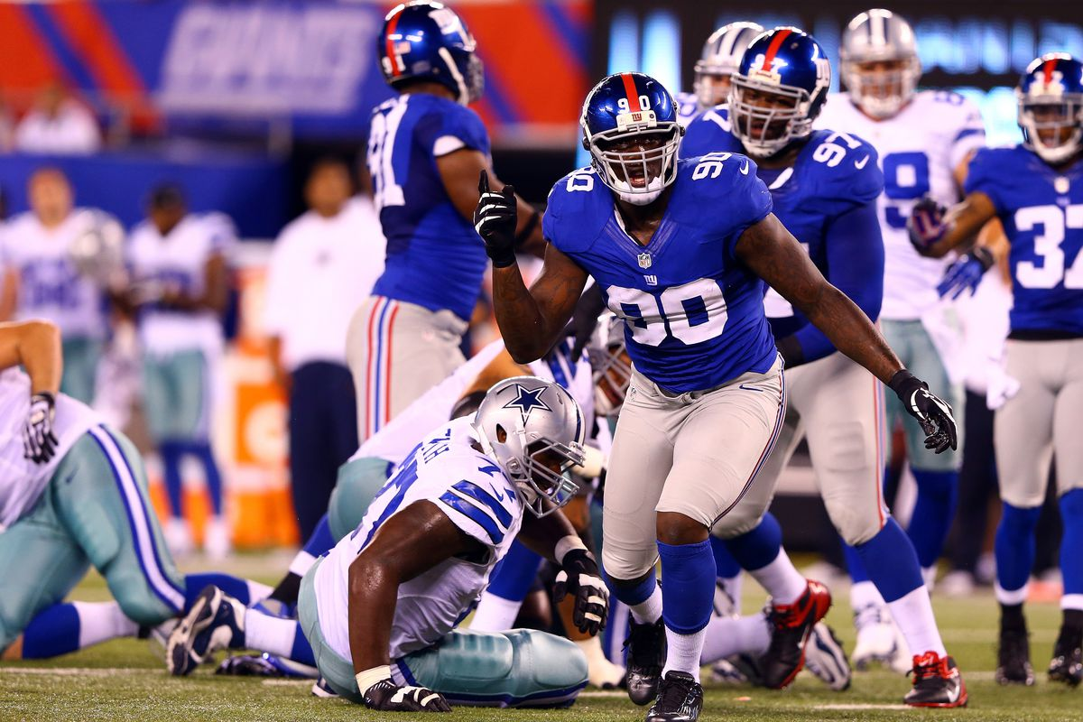 Defensive end Jason Pierre-Paul (90) of the New York Giants reacts after a tackle against the Dallas Cowboys during the 2012 NFL season opener at MetLife Stadium on September 5, 2012 in East Rutherford, New Jersey. (Photo by Al Bello/Getty Images)