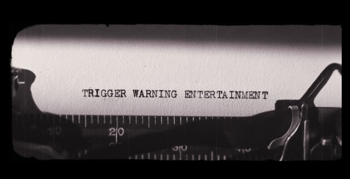 """Typewriter with the phrase """"TRIGGER WARNING ENTERTAINMENT"""""""