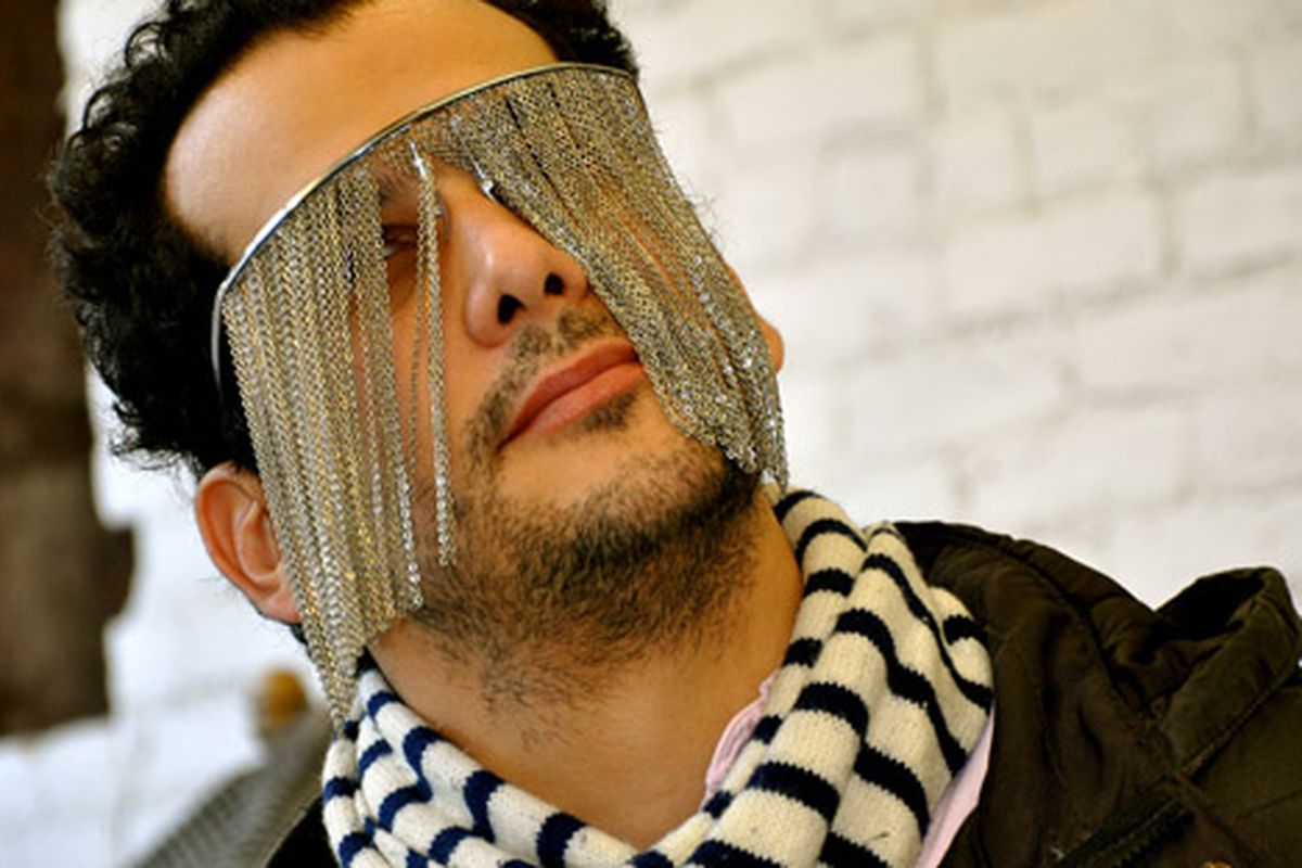 """Trying on shades at Project #8.  Via <a href=""""http://www.flickr.com/photos/essgee/4089113933/in/pool-rackedny"""">EssG</a>/Racked Flickr Pool"""