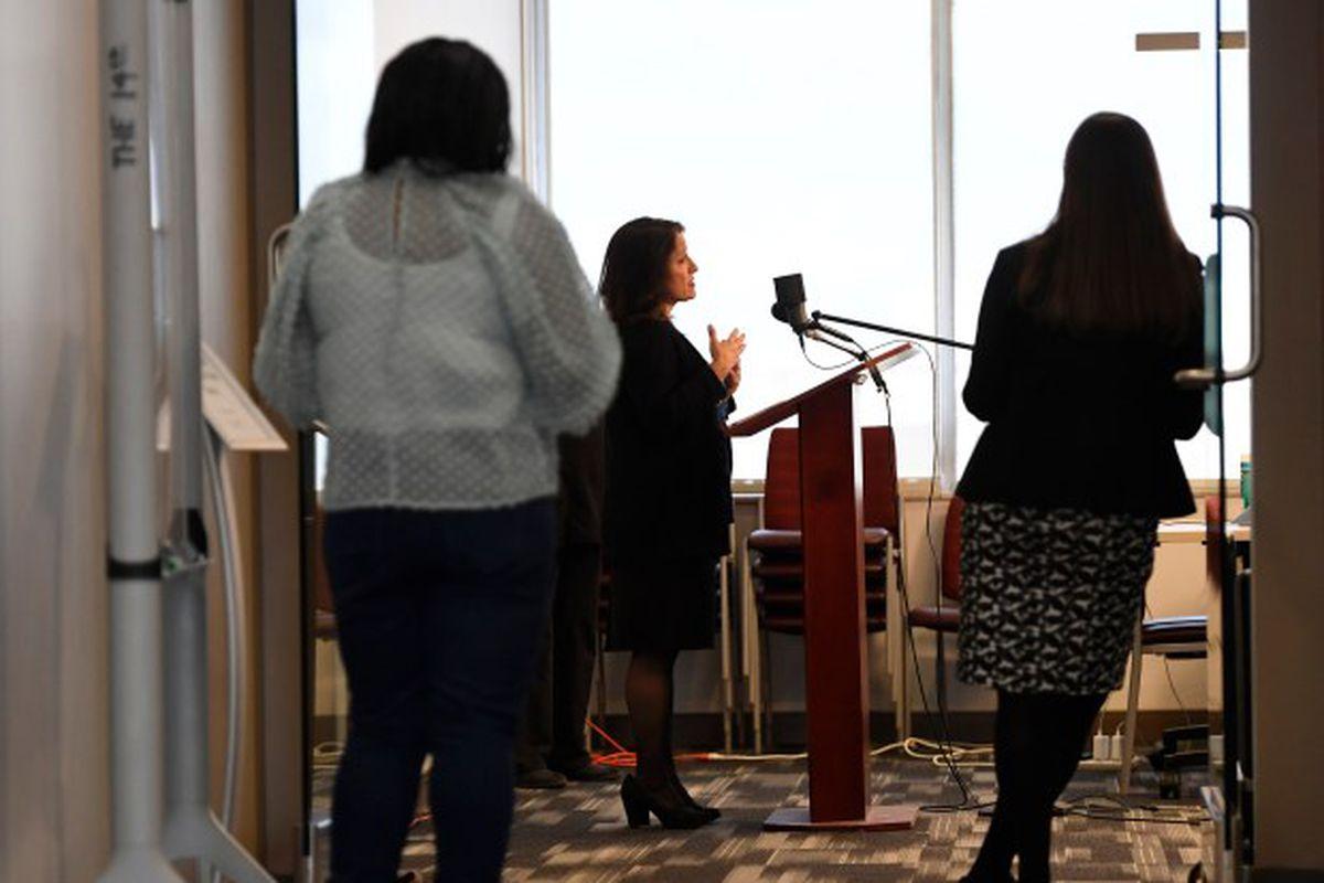Denver schools Superintendent Susana Cordova is depicted in profile speaking at a podium.
