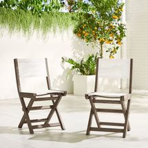 2 gray bistro chairs with fabric backs