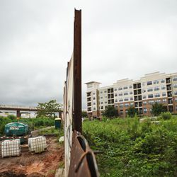 The unpaved section of trail is separated from undeveloped land and an apartment development south of Edgewood Avenue.