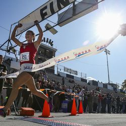 Grand County High School runner Kylah Ricks celebrates as she crosses the finish line in first with a time of 18:50.2 during the 3A Girls State Cross-Country Championships at Highland High School in Salt Lake City on Wednesday, Oct. 23, 2019.