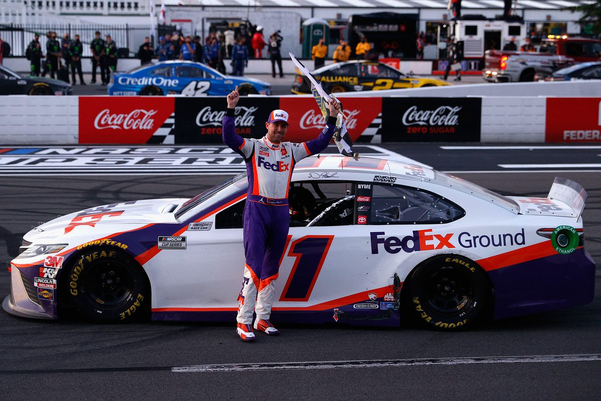 Denny Hamlin, driver of the #11 FedEx Ground Toyota, celebrates after winning the NASCAR Cup Series Pocono 350 at Pocono Raceway on June 28, 2020 in Long Pond, Pennsylvania.
