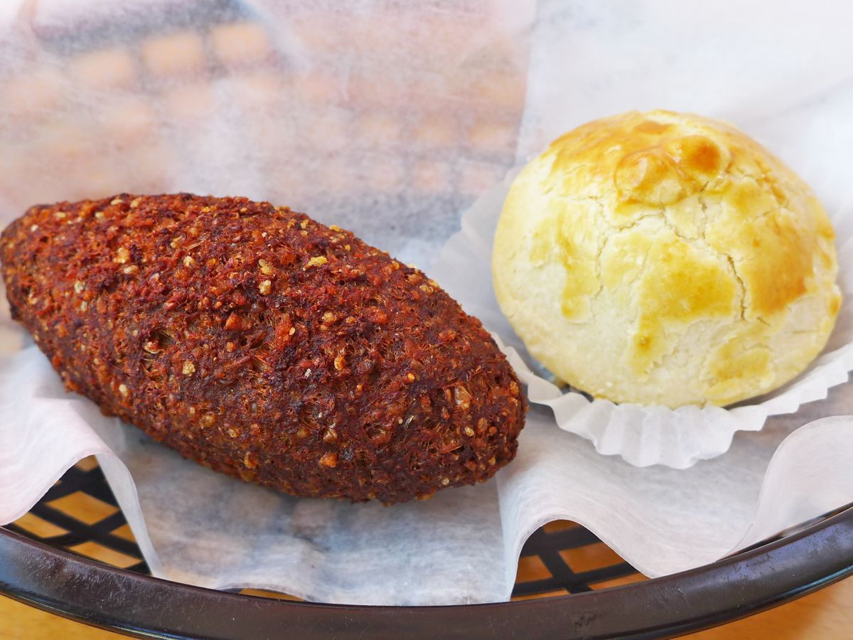 Middle Eastern tapered dark brown kibbie and Brazilian cheese ball in a plastic basket...