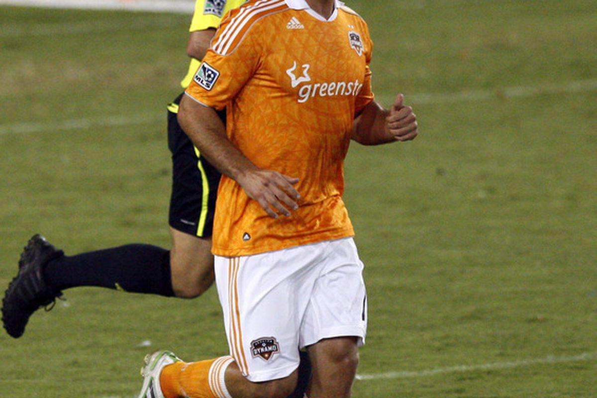 HOUSTON - APRIL 29:  Forward Will Bruin #12 of the Houston Dynamo smiles after scoring his third goal of the game against D.C. United at Robertson Stadium on April 29, 2011 in Houston, Texas. Houston 4-1. (Photo by Bob Levey/Getty Images)