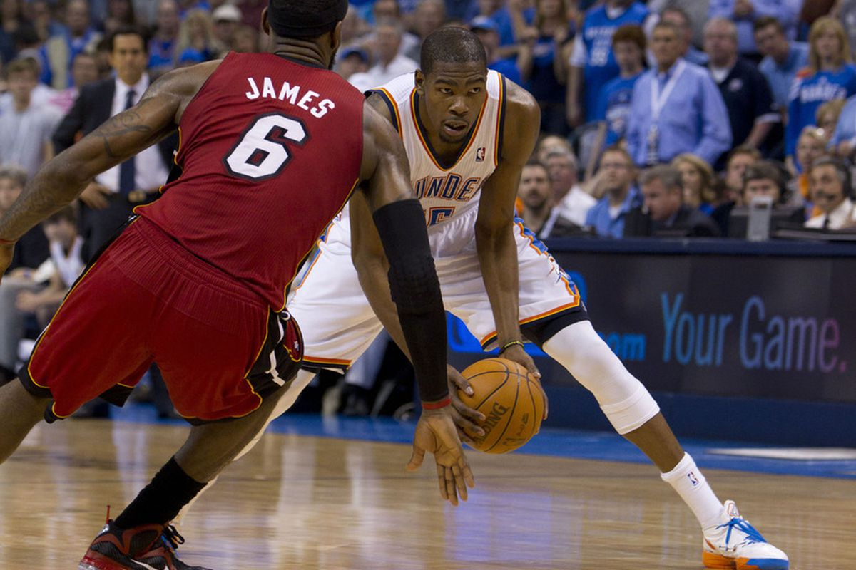Mar, 25, 2012; Oklahoma City  OK, USA; Oklahoma City Thunder small forward Kevin Durant (35) in action against Miami Heat small forward LeBron James (6) during the second quarter at Chesapeake Energy Arena Mandatory Credit: Richard Rowe-US PRESSWIRE