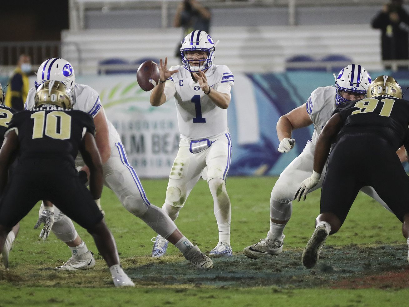 Brigham Young Cougars quarterback Zach Wilson (1) takes a snap during the Boca Raton Bowl in Boca Raton, Fla., on Tuesday, Dec. 22, 2020.