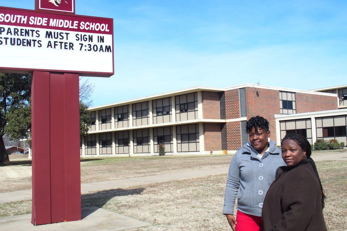 From left: Parents Charlotte Smith and Nadia Holmes stand in front of South Side Middle before the South Memphis school  was shuttered in 2015. The decision by leaders of Shelby County Schools impacted 300 students.
