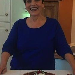 Nancy Judd displays her world championship pie at home in her Alpine kitchen.