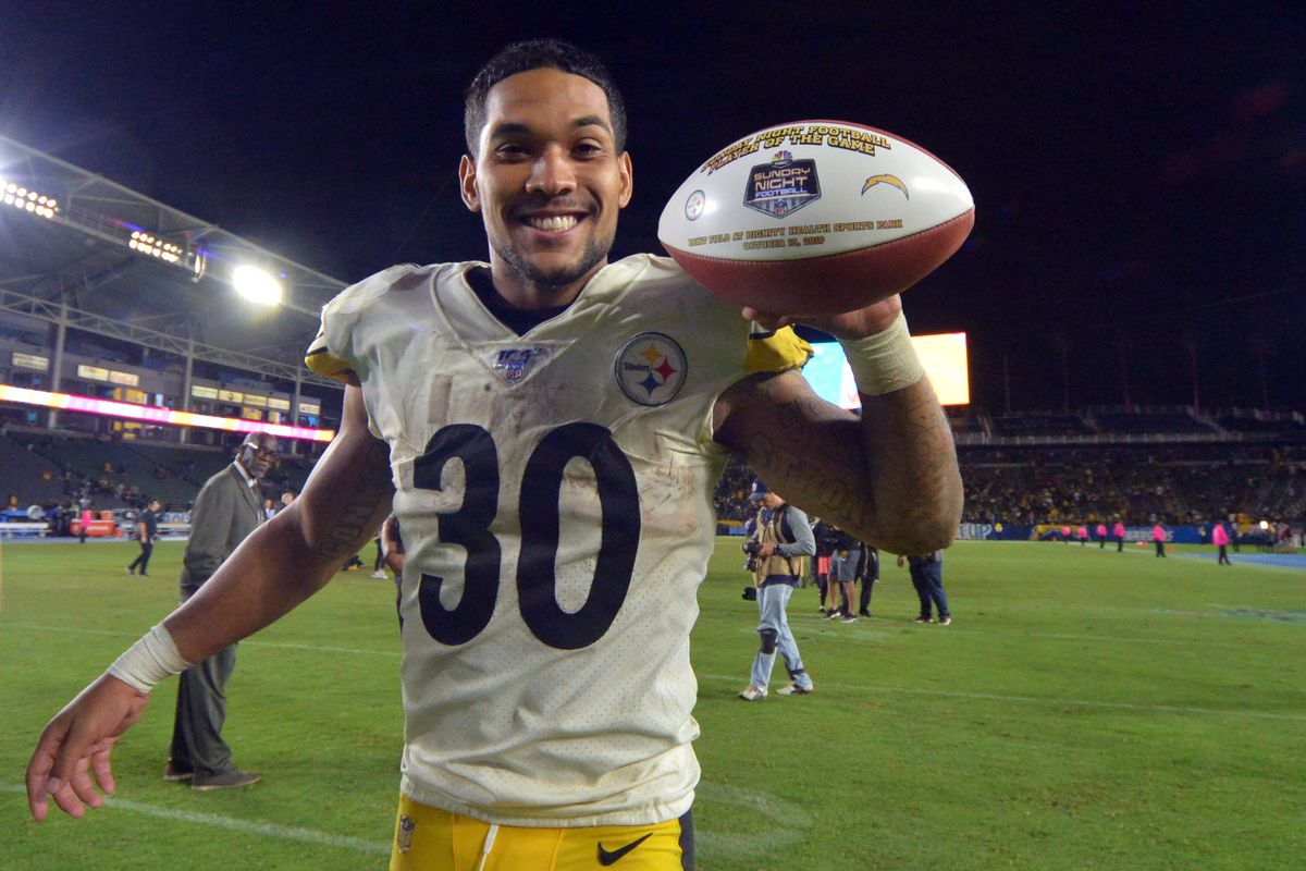 Pittsburgh Steelers running back James Conner celebrates a 24-17 win over the Los Angeles Chargers with the game ball at Dignity Health Sports Park.