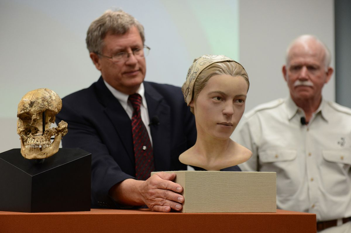 Archaeologists with a reconstruction of the Jamestown cannibalism victim.