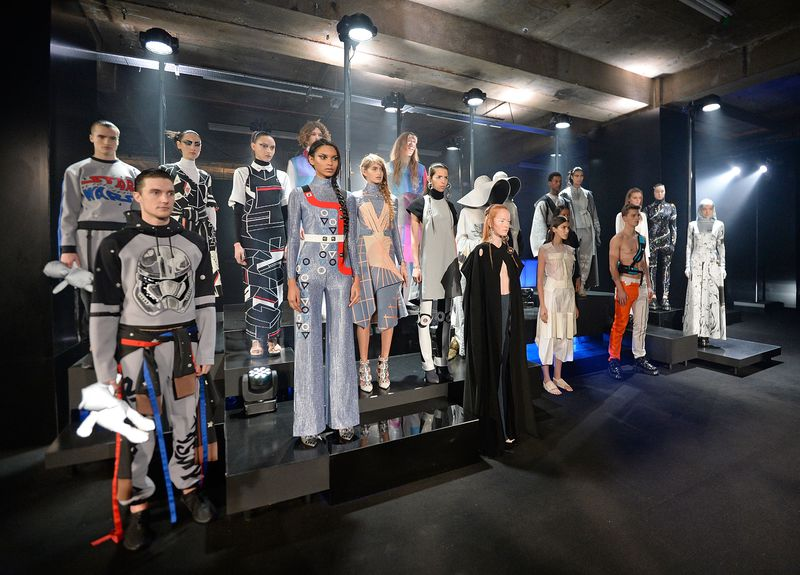 Numerous models pose in futuristic Star Wars-inspired outfits at the Star Wars: Fashion Finds The Force exhibit in London.