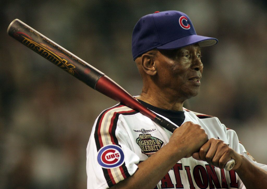 Hall of Fame Chicago Cubs shortstop Ernie Banks gives an interview during the All Star Legends and Celebrity softball game Sunday, July 11, 2004 at Minute Maid Park in Houston. (AP Photo/Eric Gay)