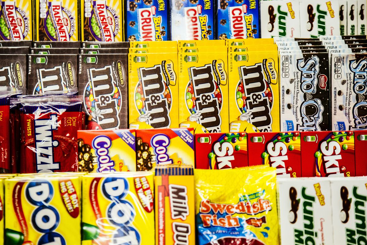 A display of movie theater candy including M&Ms, Dots, Twizzlers, and Sno-Caps.