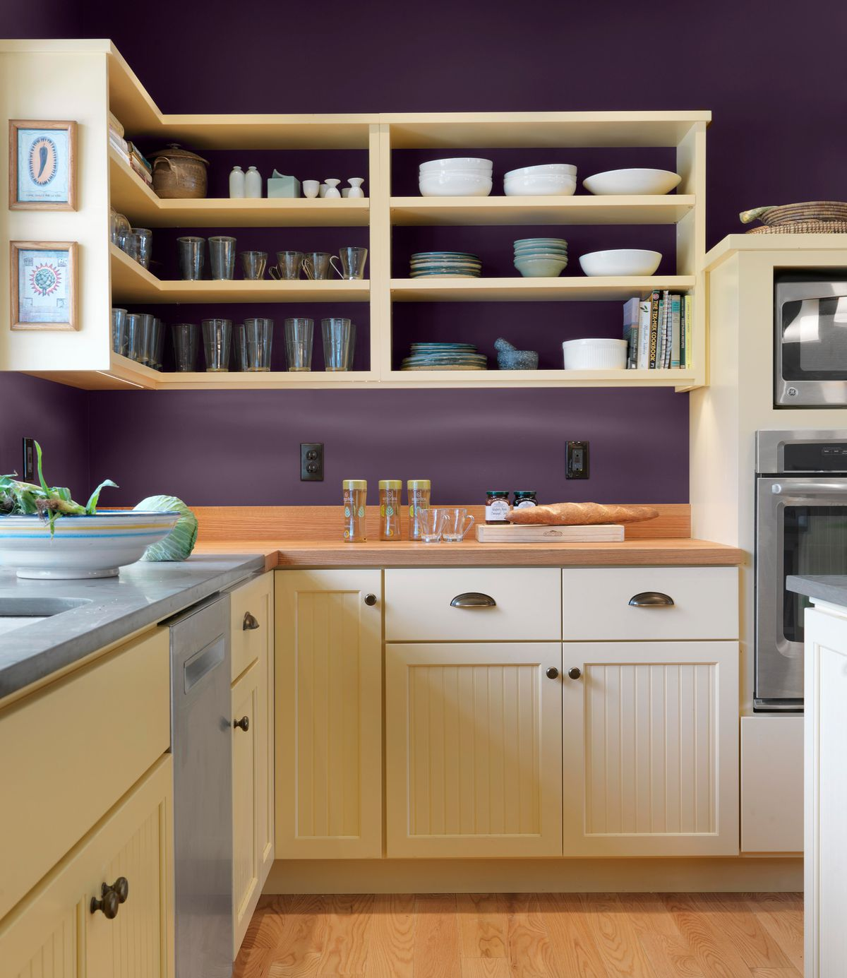 Purple painted kitchen with yellow cabinets.