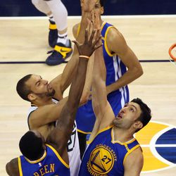 Utah Jazz center Rudy Gobert (27) shoots over Golden State Warriors center Zaza Pachulia (27) during game 4 of the second round of NBA playoffs at the Vivint Smart Home Arena in Salt Lake City on Monday, May 8, 2017.