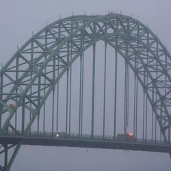 This Jan. 18, 2012 photo shows the Yaquina Bay Bridge, Newport, Ore. A woman who appealed for money online to help care for her autistic son and disabled husband has been accused of throwing her 6-year-old boy to his death off the historic bridge on Monday, Nov. 3, 2014.