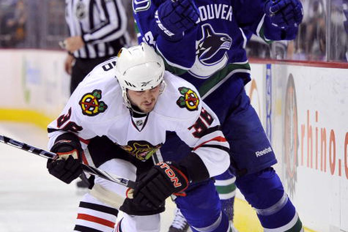 """<strong>Dave Bolland hits a Sedin.  It doesn't matter which one.  </strong>(Photo by Rich Lam/Getty Images)  via <a href=""""http://cdn.picapp.com/ftp/Images/2/3/3/a/Chicago_Blackhawks_v_4744.jpg?adImageId=13041904&imageId=8710569"""">cdn.picapp.com</a>"""