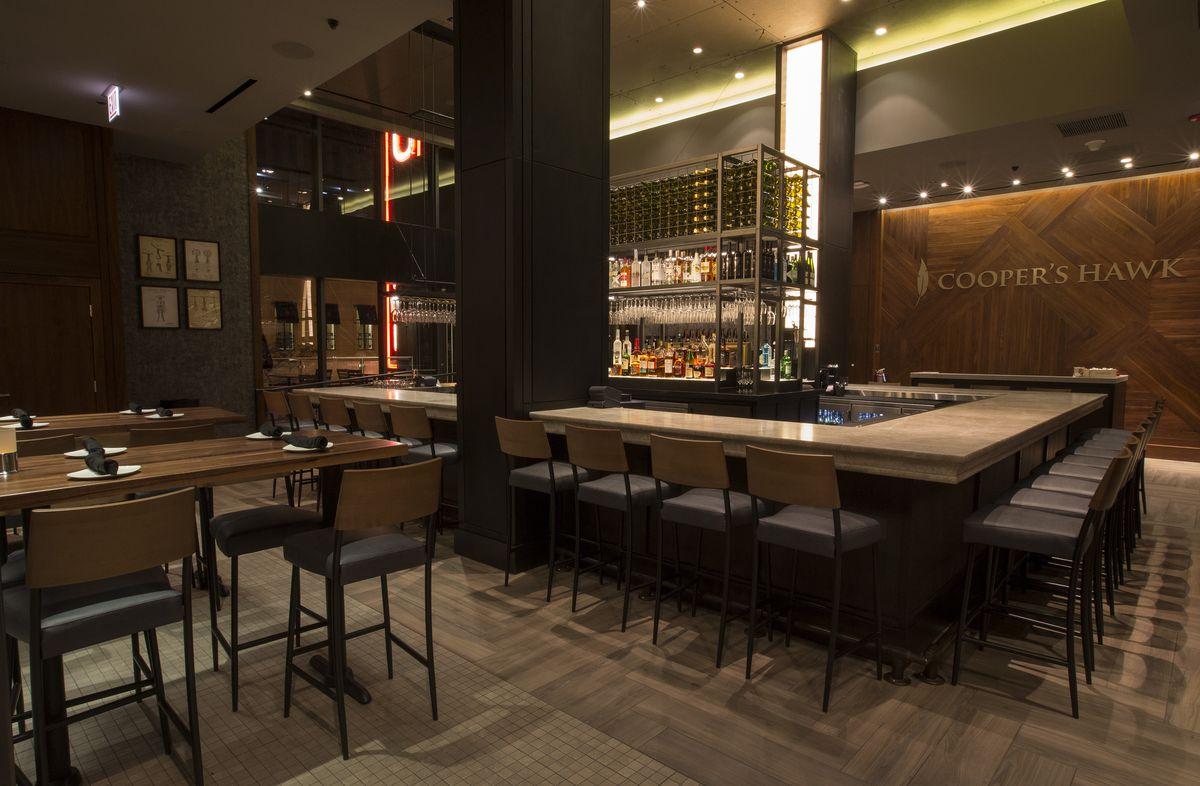 A white rectangular bar wraps around the center of the room.