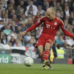 Bayern Munich's Arjen Robben of the Netherlands shoots to score from a penalty during a semifinal, second leg Champions League soccer match against Real Madrid at the Santiago Bernabeu stadium in Madrid Wednesday April 25, 2012.