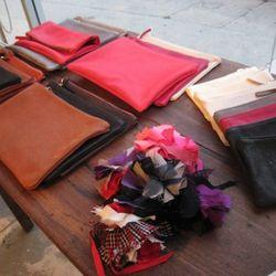 Versatile pouches and pom-pom bag adornments