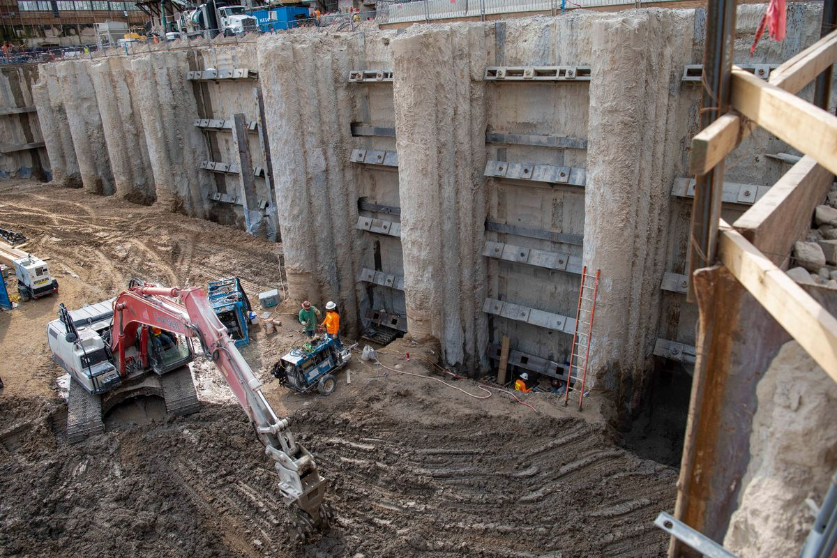 Crew members dig to prepare the secant wall for new underground levels that will be added to the temple, Salt Lake City, Utah, Sept. 2021.