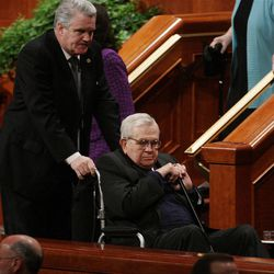 President Boyd Packer is escorted out after  the 182nd Annual General Conference for The Church of Jesus Christ of Latter-day Saints in Salt Lake City  Sunday, April 1, 2012.