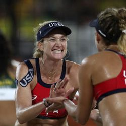 United States' Kerri Walsh Jennings, center, celebrates a point with teammate April Ross while playing Brazil during the women's beach volleyball bronze medal match of the 2016 Summer Olympics in Rio de Janeiro, Brazil, Wednesday, Aug. 17, 2016. (AP Photo/Petr David Josek)