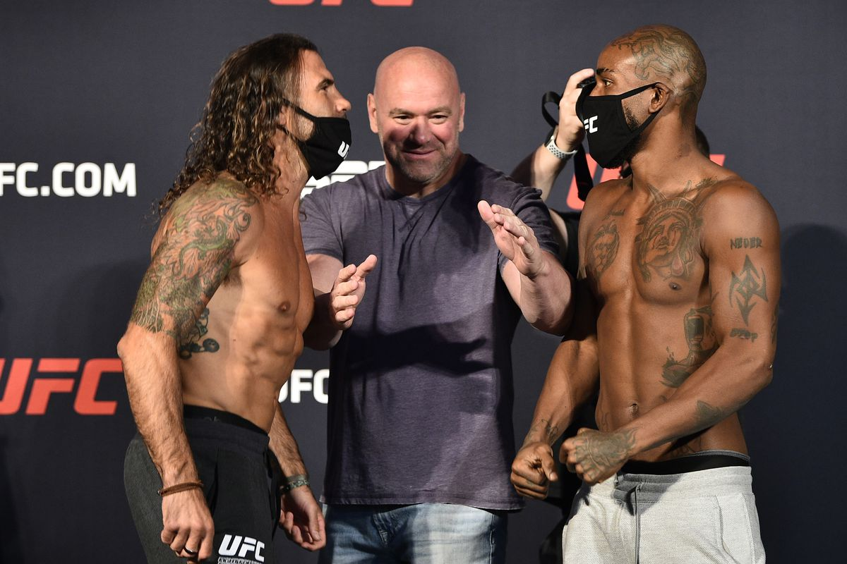 In this handout image provided by UFC, opponents Clay Guida and Bobby Green face off during the UFC weigh-in at UFC APEX on June 19, 2020 in Las Vegas, Nevada.