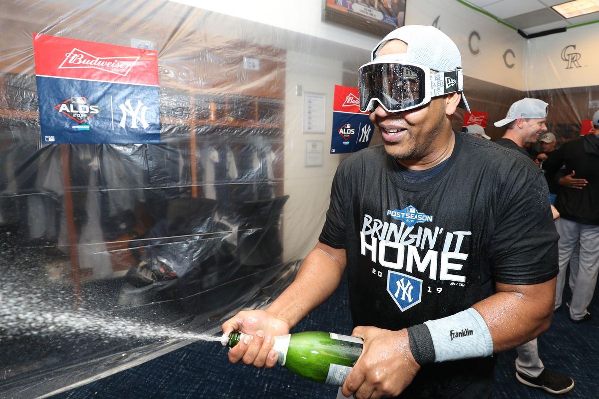 The New York Yankees celebrate their victory in the locker room after defeating the Minnesota Twins in game three of the 2019 ALDS playoff baseball series at Target Field.