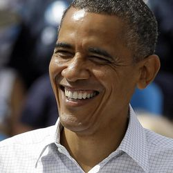 President Obama smiles at supporters during a campaign rally Saturday, Sept. 8, 2012, in Seminole, Fla.