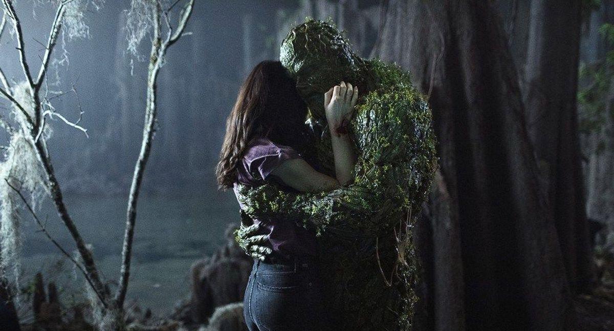 Swamp Thing hugs a girl