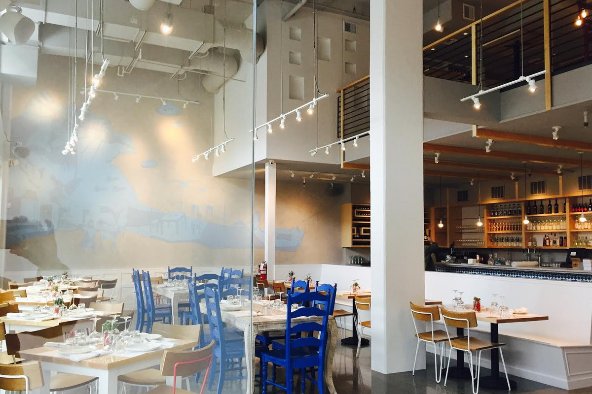 The interior of Capitol Hill restaurant Omega Ouzeri, with lots of blue and white accents