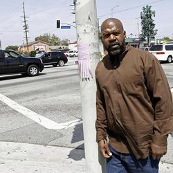 On April 19, 2012, Henry Keith Watson poses for a portrait on the corner of Florence and Normandie in Los Angeles, where Watson and others dragged truck driver Reginald Denny from his cab and beat him severely on the first night of rioting.  The acquittal of four police officers in the videotaped beating of King sparked rioting that spread across the city and into neighboring suburbs. Cars were demolished and homes and businesses were burned. Before order was restored, 55 people were dead, 2,300 injured and more than 1,500 buildings were damaged or destroyed.(