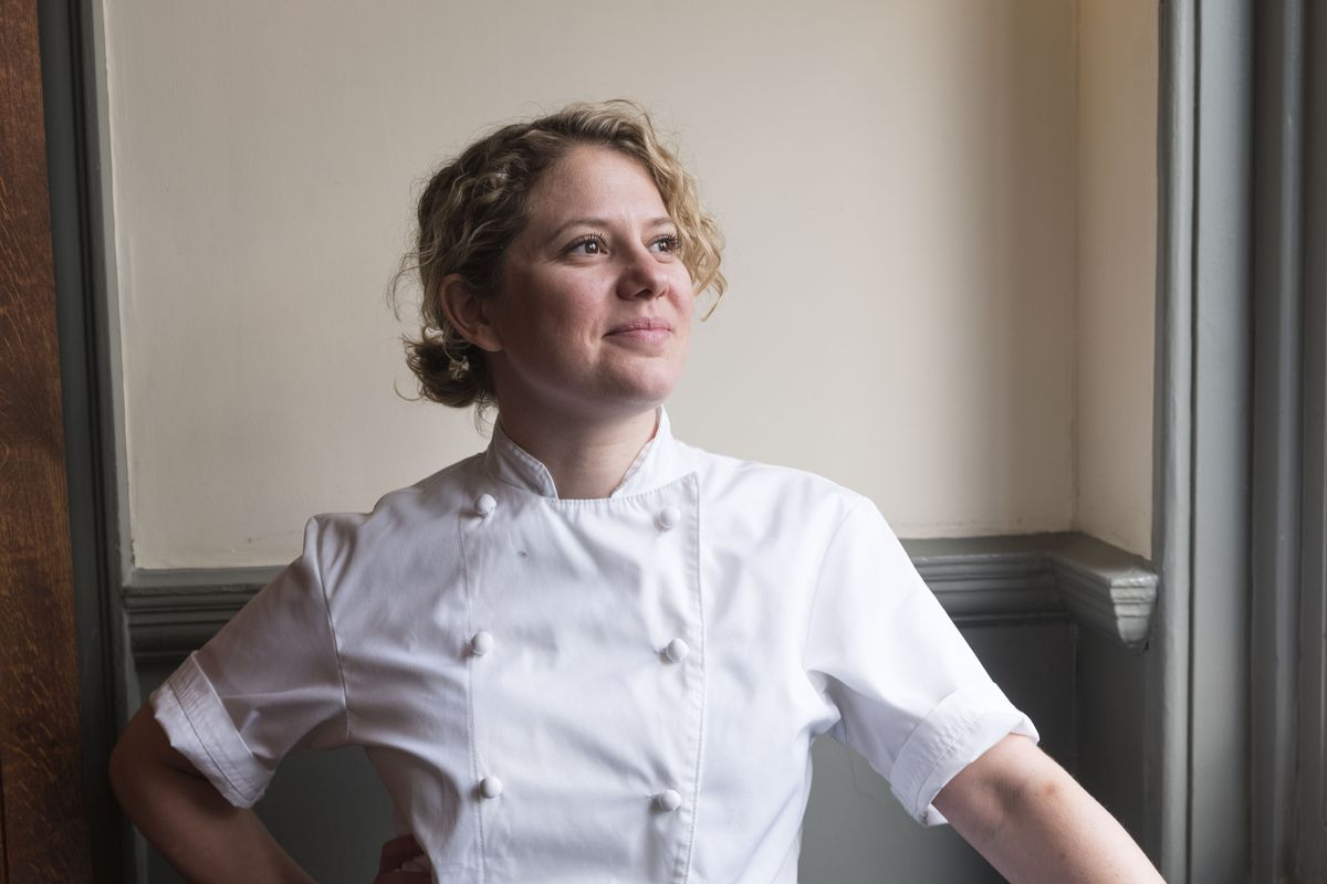 Chef Sally Abé in portrait, dressed in chefs' whites