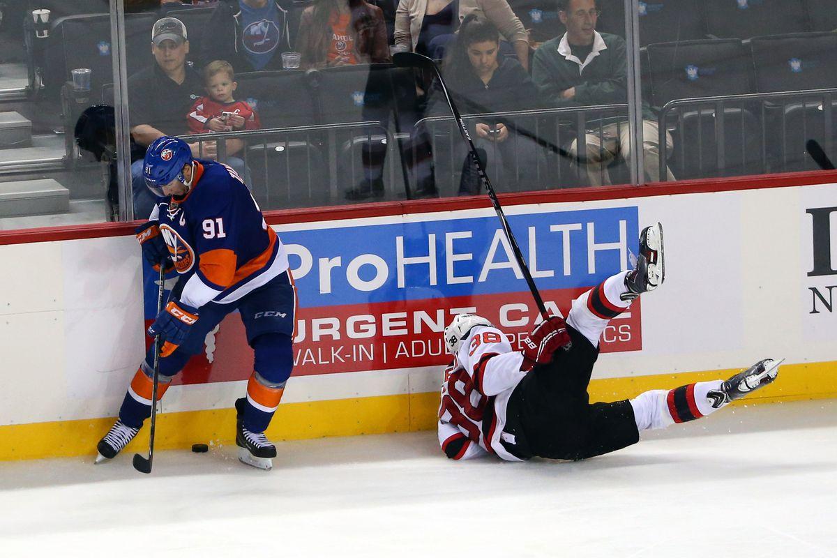 For whatever reason, the photostream has nothing from the 11/29/14 game. So here's a picture of preseason of John Tavares trying to find the puck while Stefan Matteau was put on his wallet.
