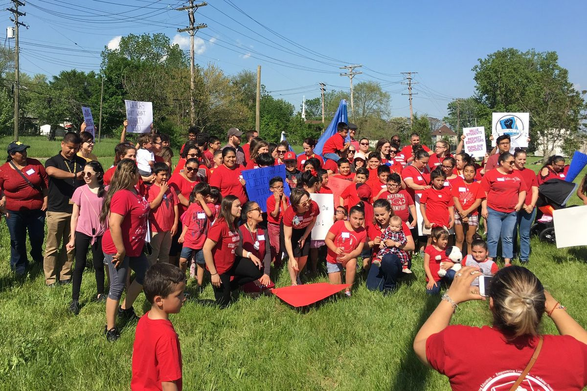 Southwest Detroit Community School families wearing union tee shirts gathered near the school in June before marching to demand a new  contract for teachers.