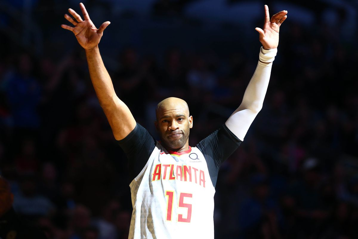 Atlanta Hawks guard Vince Carter waves to fans as he is honored during the first half against the Orlando Magic at Amway Center.