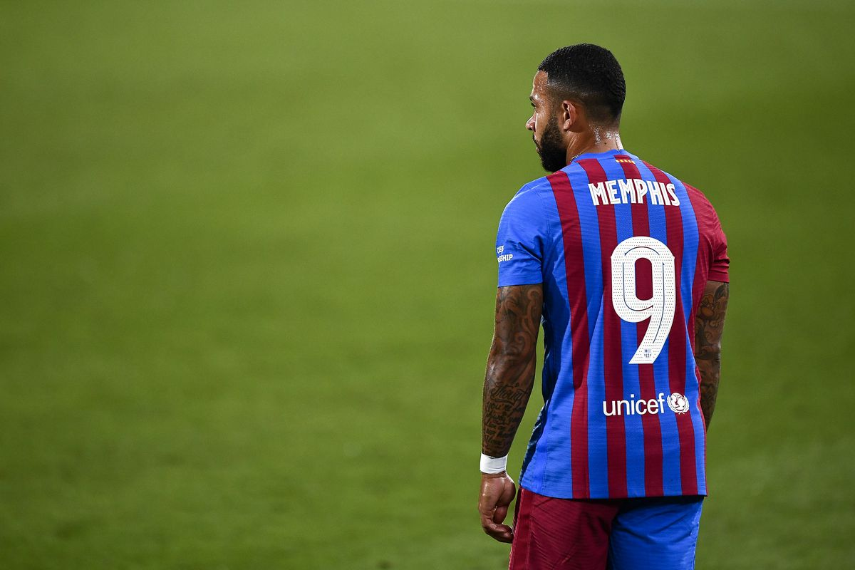 Memphis Depay of FC Barcelona looks on during the pre-season...