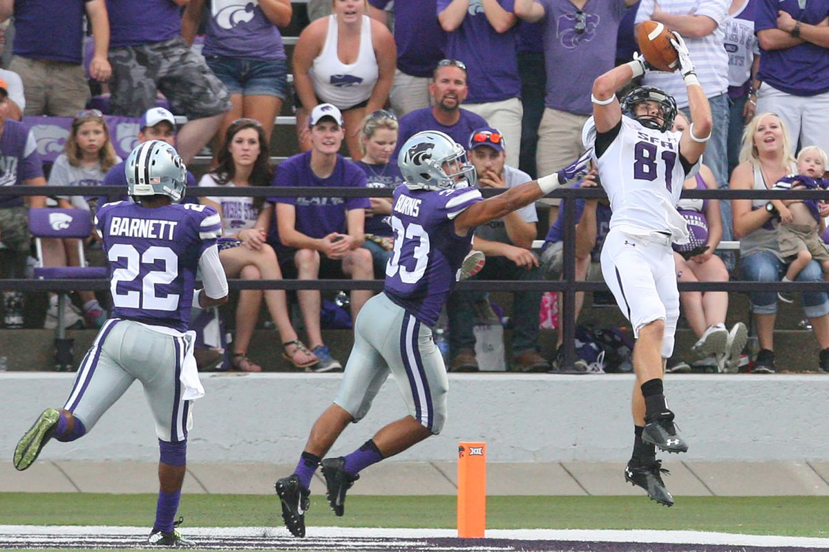 I don't know what Barnett is doing here, but Burns is tickling Stephen F. Austin wide receiver Aaron Thomas. Burns' clever ploy worked, Thomas didn't catch the touchdown pass.