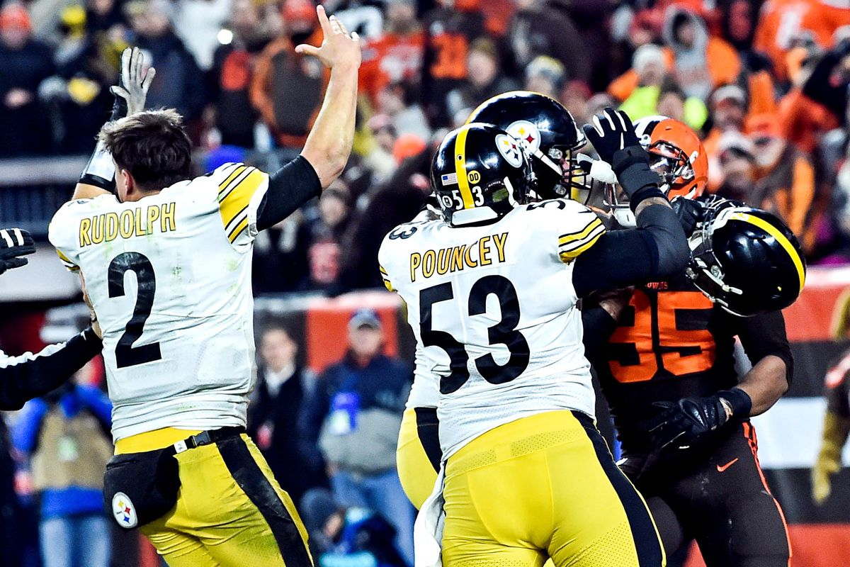 Cleveland Browns defensive end Myles Garrett hits Pittsburgh Steelers quarterback Mason Rudolph with his own helmet as offensive guard David DeCastro tries to stop Garrett during the fourth quarter at FirstEnergy Stadium.