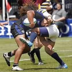 BYU's Kody Thompson collides with Cal's Alec Gletzer as BYU defeats Cal 27-24 in rugby on a drop as time expires to win the Varsity Cup national championship Saturday, May 4, 2013, in Provo.