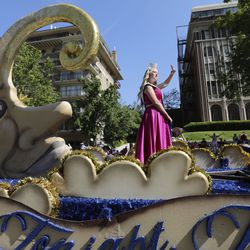 Miss Bluffdale waves from the city's float in the Days of '47 Parade in Salt Lake City on Friday, July 23, 2021. The float won the Ensign Award.
