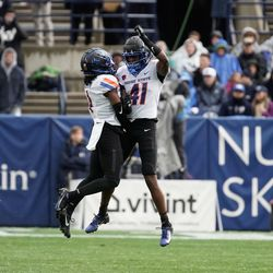 Boise State players celebrate while playing against BYU in an NCAA college football game at LaVell Edwards Stadium in Provo on Saturday, Oct. 9, 2021.