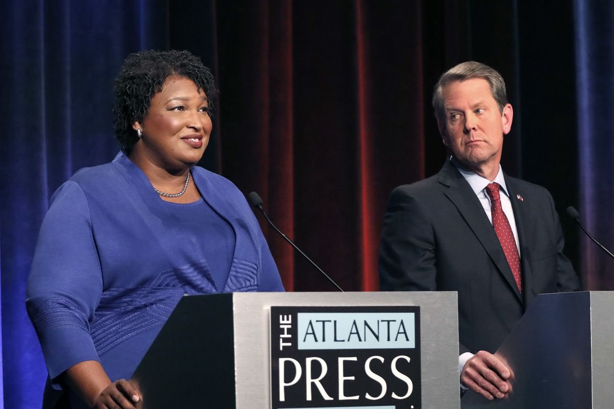 FILE - In this Tuesday, Oct. 23, 2018 file photo, Democratic gubernatorial candidate for Georgia Stacey Abrams, left, speaks as her Republican opponent Secretary of State Brian Kemp looks on during a debate in Atlanta. A federal judge says Georgia electio