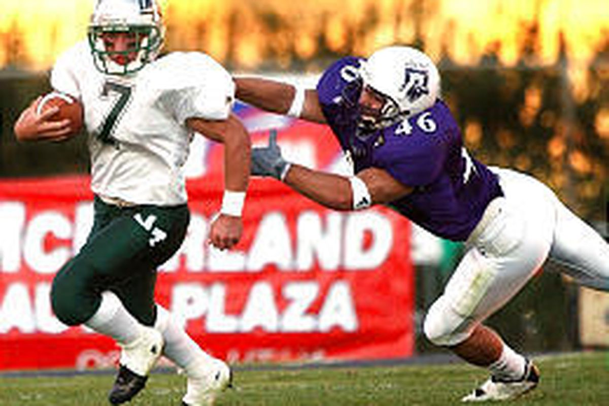 Weber State's Colton Swan tackles Montana Tech's Josh Johnson in the second quarter of Saturday's Wildcat win.
