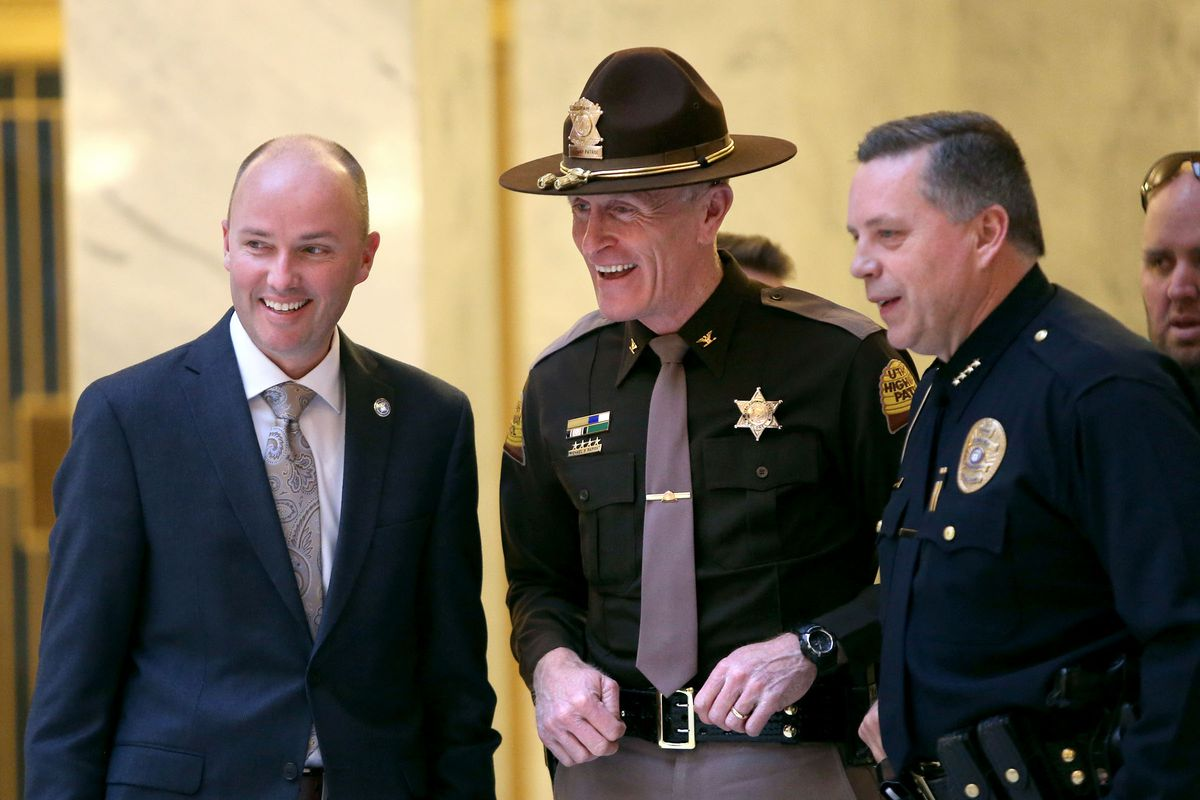 Lt. Gov. Spencer Cox, Utah Highway Patrol Col. Michael Rapich and Bountiful City Police Chief Tom Ross chat before a ceremony to declare January as Law Enforcement Appreciation Month in Utah at the Capitol in Salt Lake City on Monday, Jan. 9, 2017.