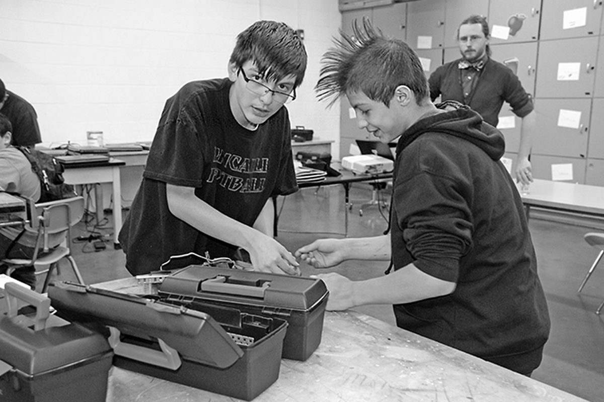 Students at Roncalli Middle School work on a robotics project in April. Part of the district's strategy to improve the state's lowest-performing school in the state was to implement a STEM curriculum.
