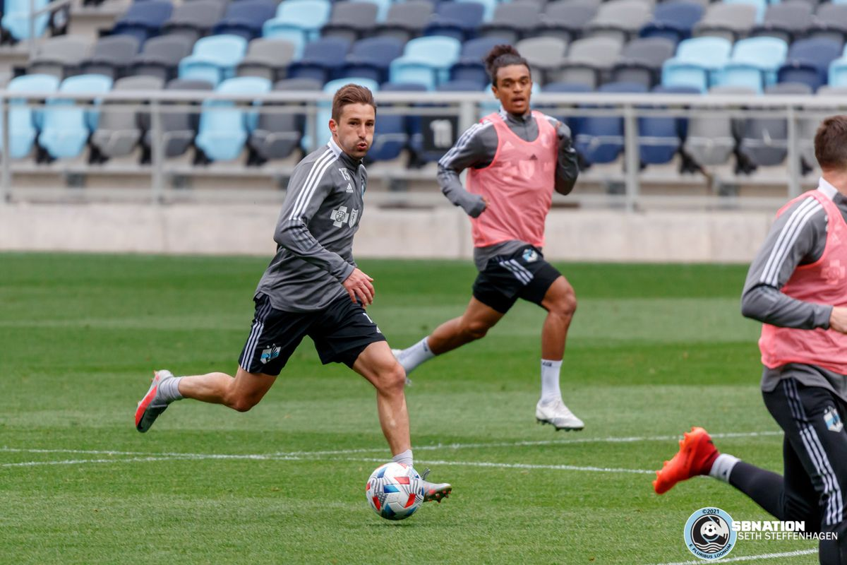 April 20, 2021 - Saint Paul, Minnesota, United States - Minnesota United midfielder Ethan Finlay (13) dribbles the ball during the Loon's first team training session at Allianz Field.
